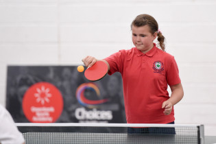 Participant of the Festival of Disability Sport taking part in the Table Tennis tournament