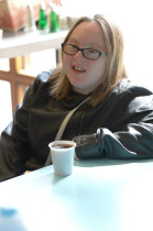 Student relaxing in the Greenbank College canteen