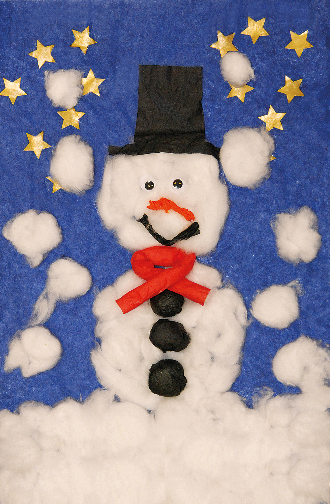 Blue background with gold start and cotton wool snow and snowman with bright red scarf